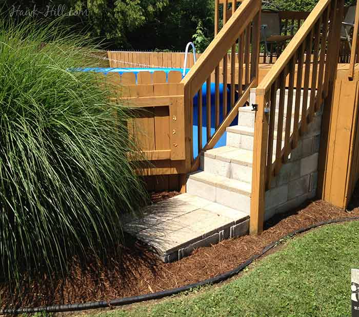 Exceptionnel Concrete Steps Wood Deck And Landscaping Around Above Ground Pool