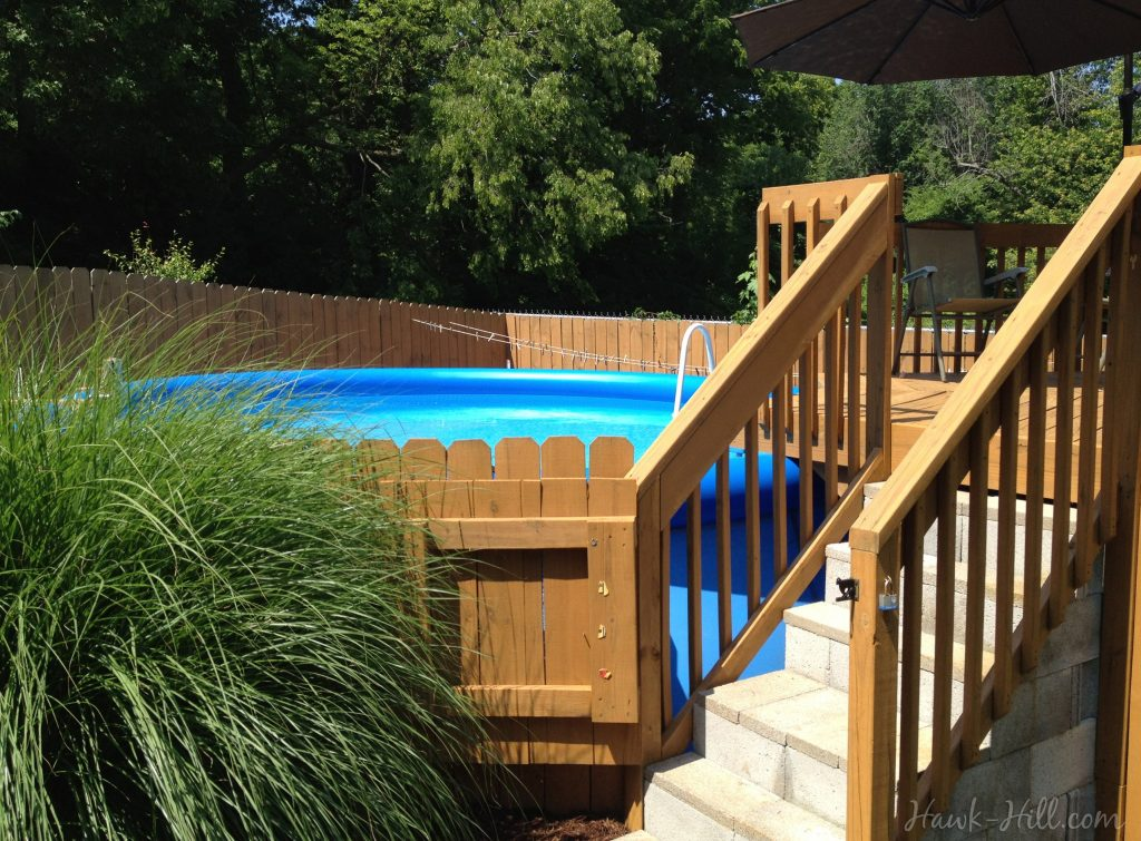 Safe and Stylish Landscaping and Deck for an Above Ground Pool