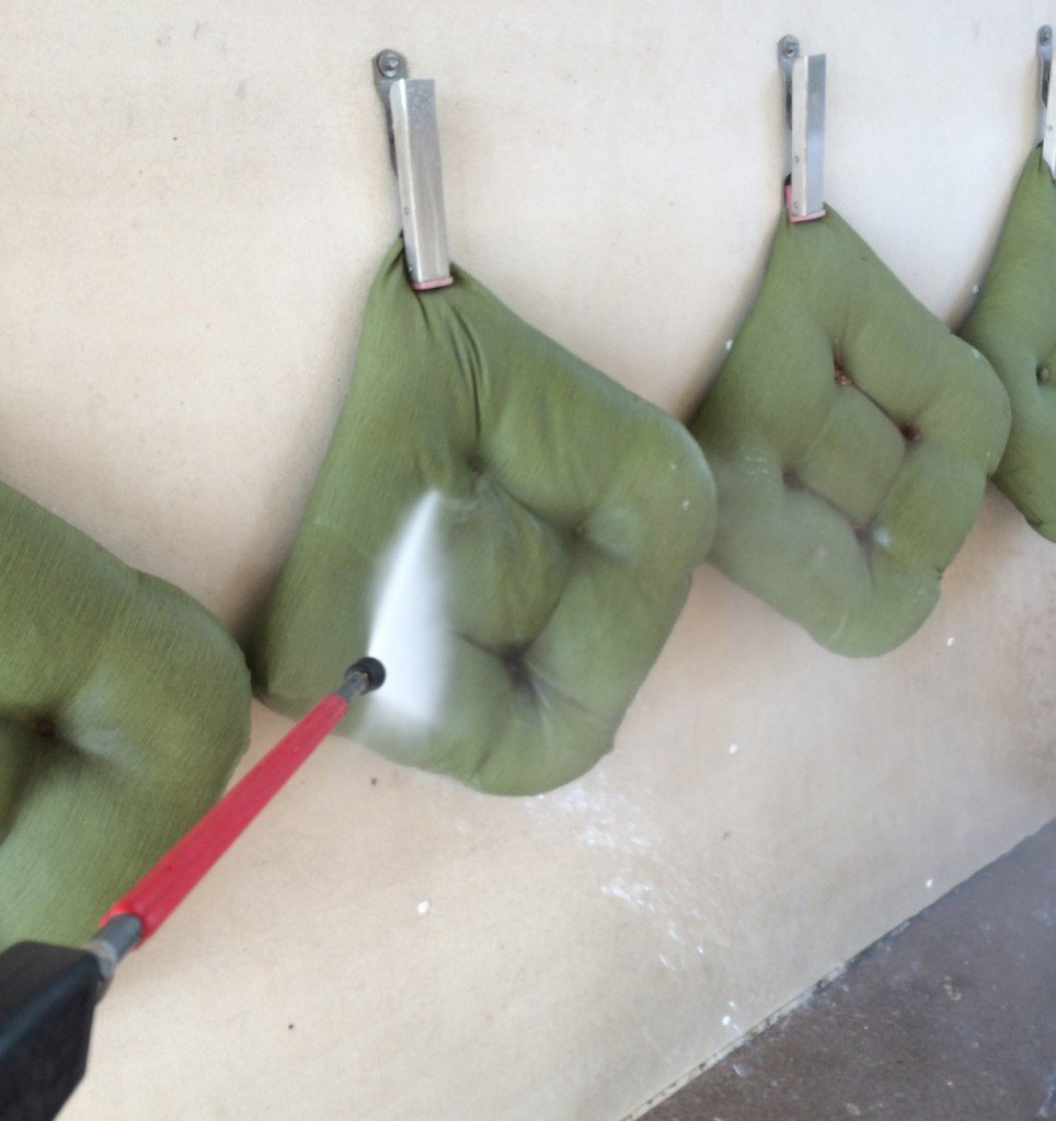 cleaning seat cushions at a car wash