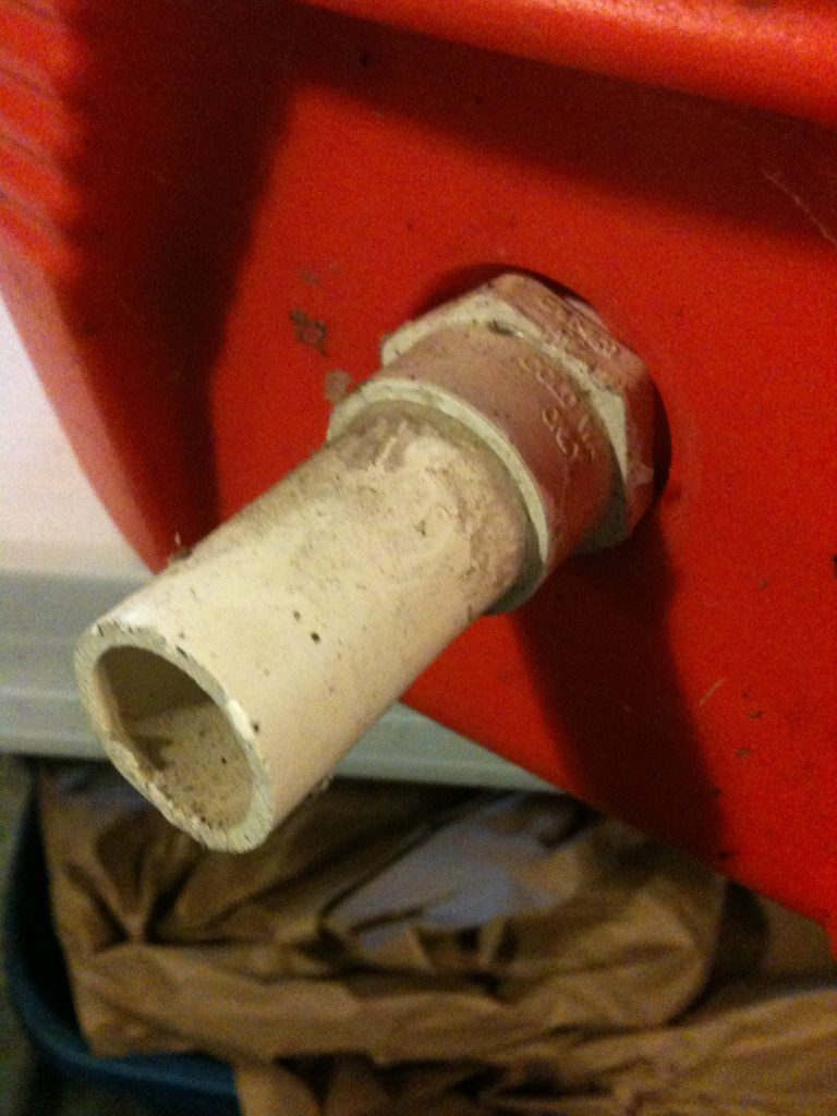 Igloo Foal Feeder Conversion: A short length of PVC pipe is glued into the fitting. The nipple is then stretched over the pipe and secured with a hose clamp.