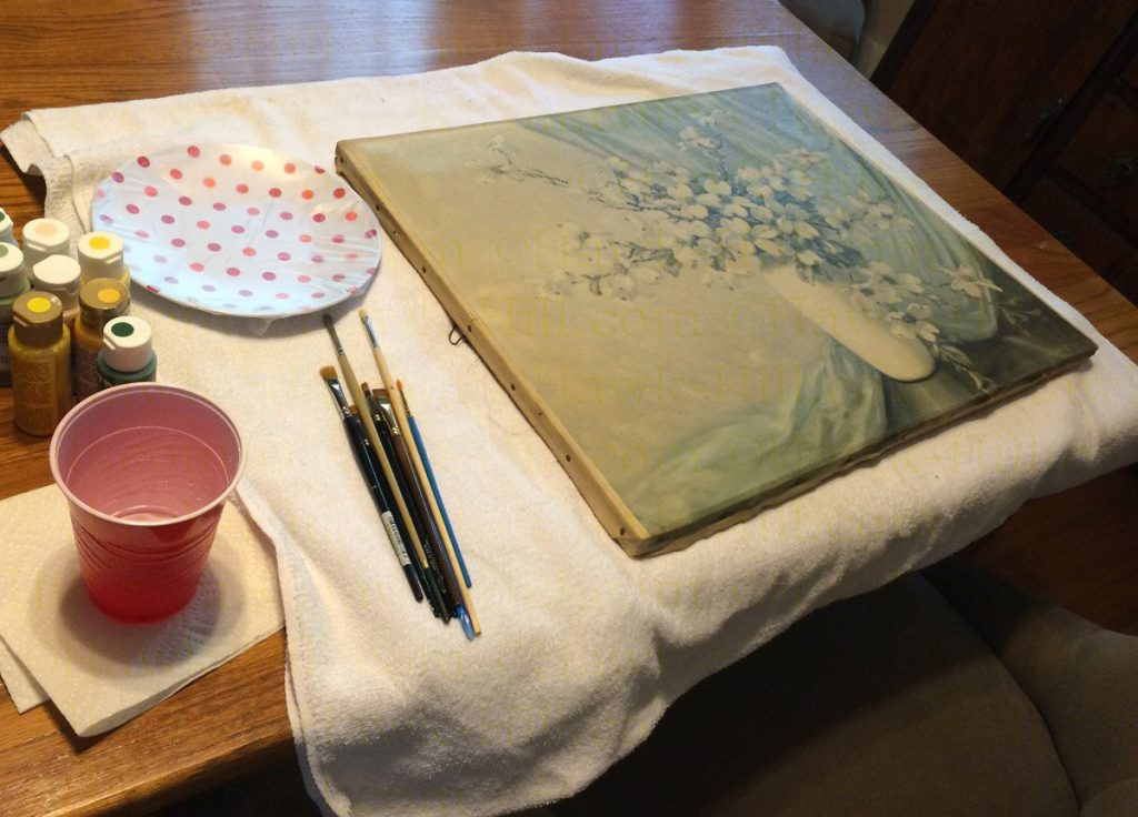 Painting over a thrift store painting to create a paint by number style painting using a DIY painters palette.