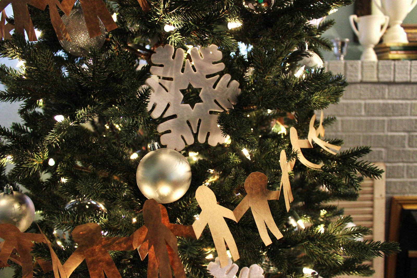handmade ginger-bread shaped paper dolls used as christmas tree garland