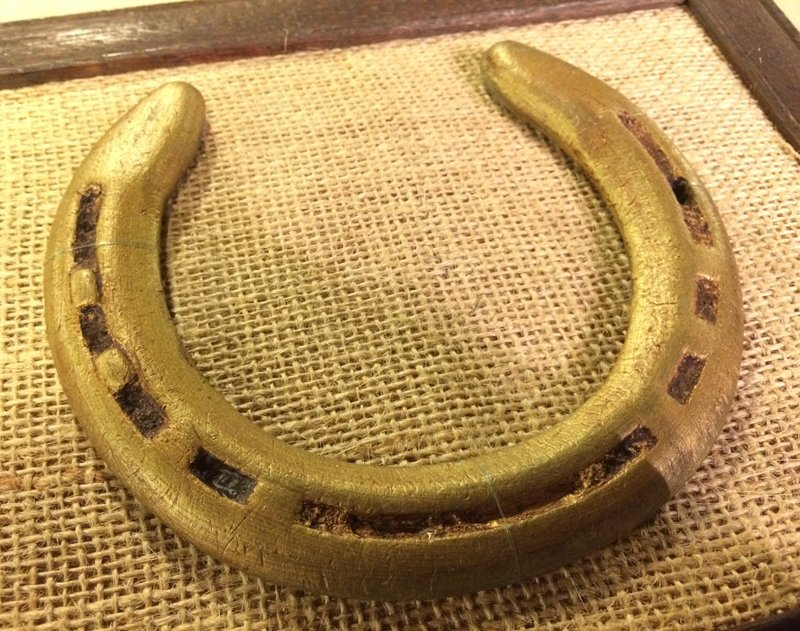horse shoe secured to burlap using fishing line