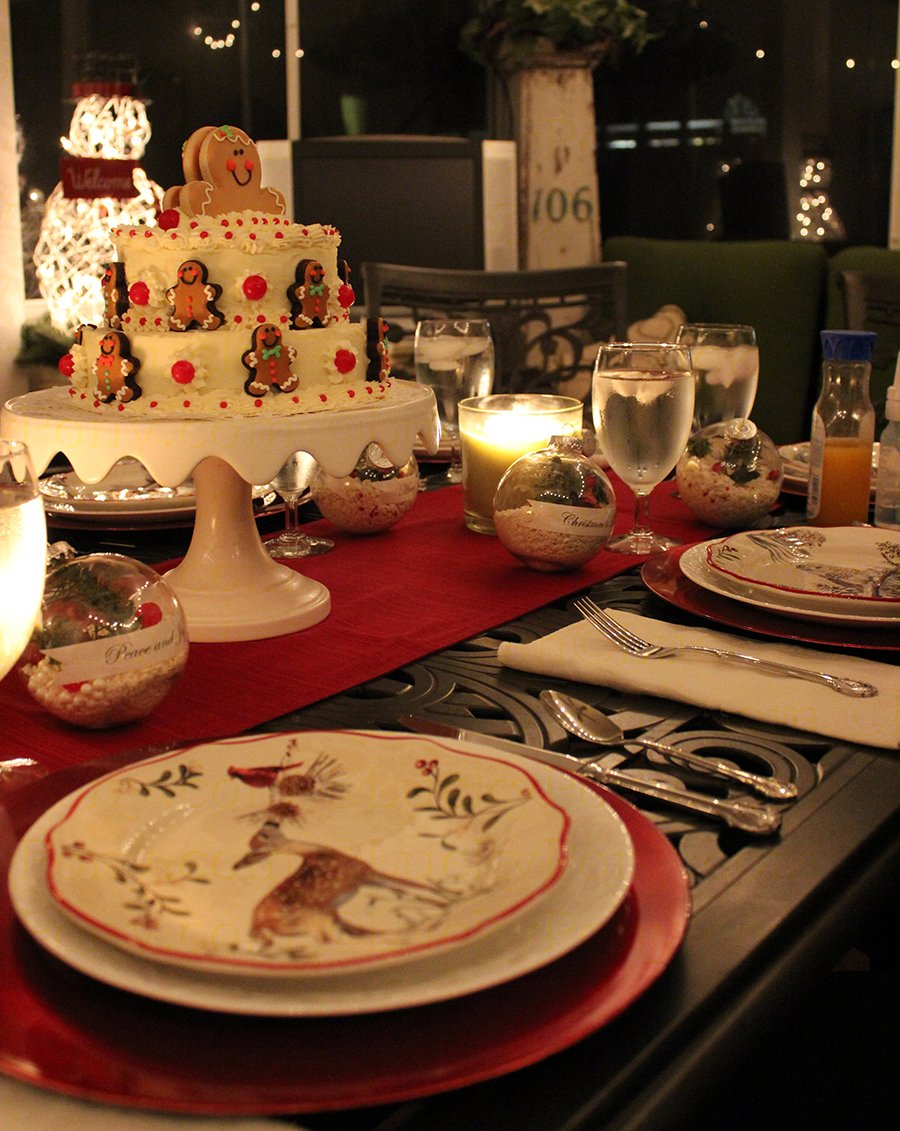 holiday table setting with christmas cake and rustic decor