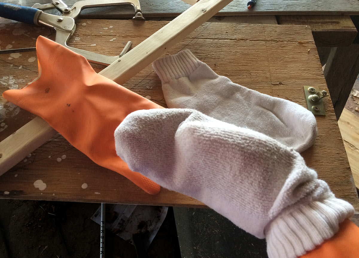 Pair a rubber glove and an inside-out-sock for a super-fast way to paint poles, posts, spindles, and thin planks.