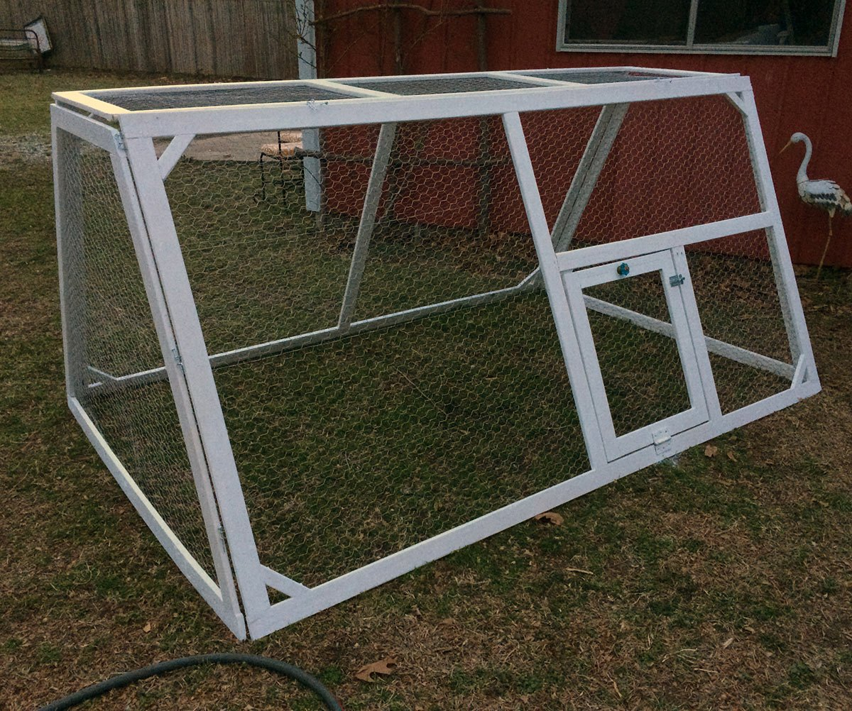 a chicken tractor is a safe way to raise chickens apart from the typical coop