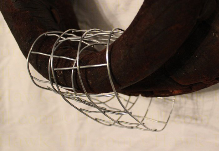 wire holds the ribbons and garland secure