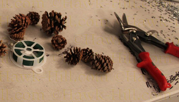 pinecones added to artificial greenery can create a more authentic look