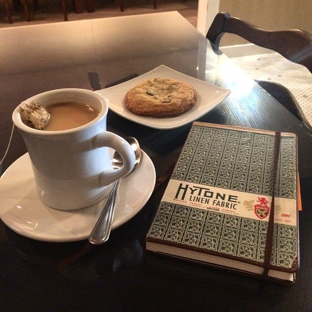bullet journal with vintage cover at my favorite coffee shop