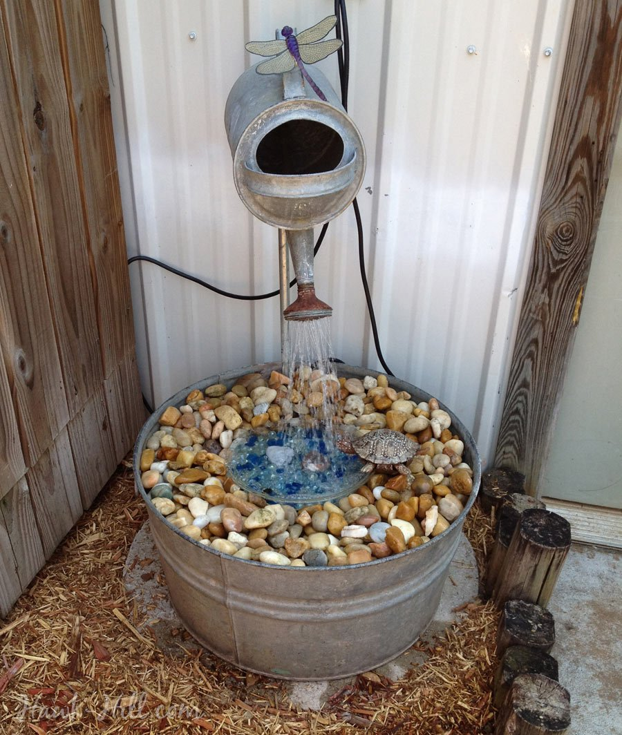 galvanized watering can fountain