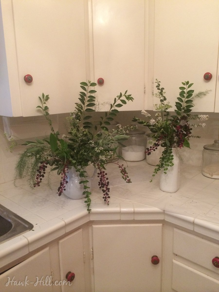 Flower arrangements made with weeds, greens, and landscape clippings