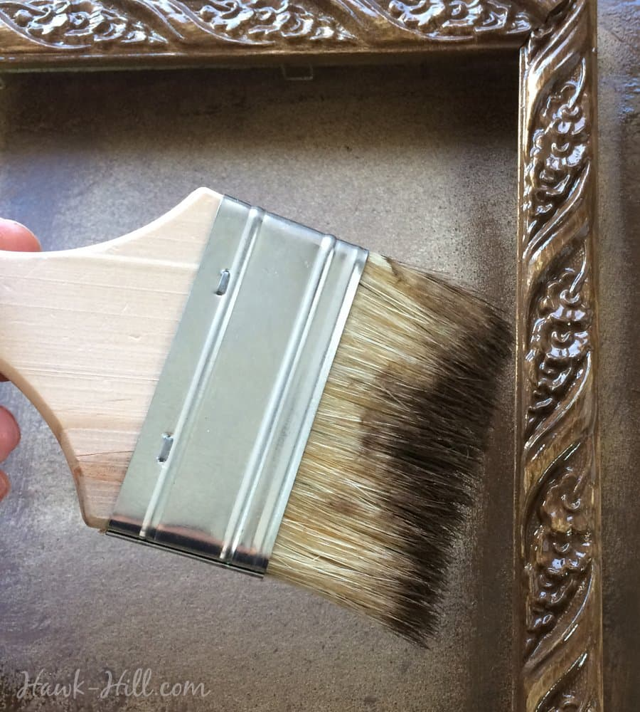 Use a paintbrush to get the brown paint deep into crevices