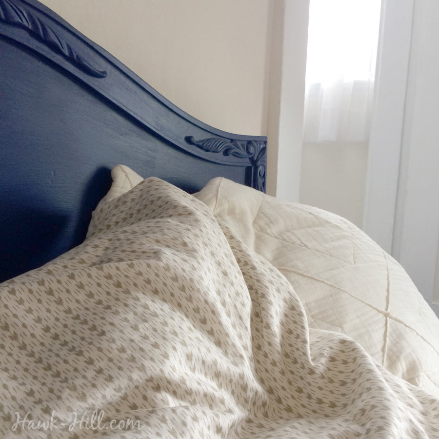 royal blue headboard and linens