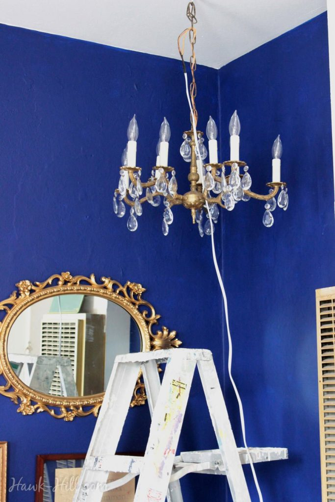 hanging a chandelier in a rental apartment