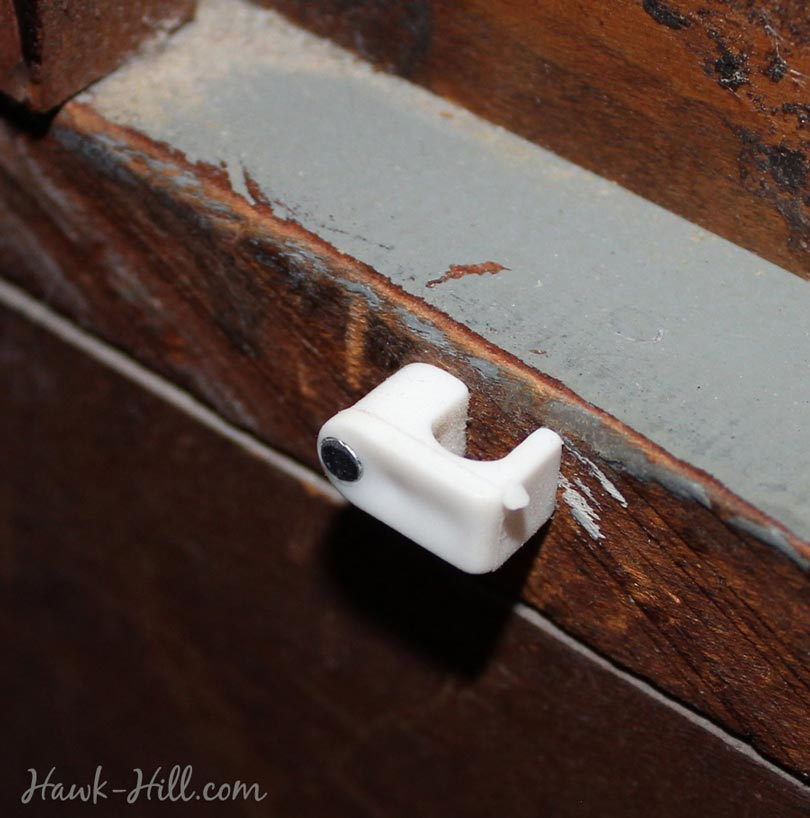 cable clip on the back of a vintage dresser