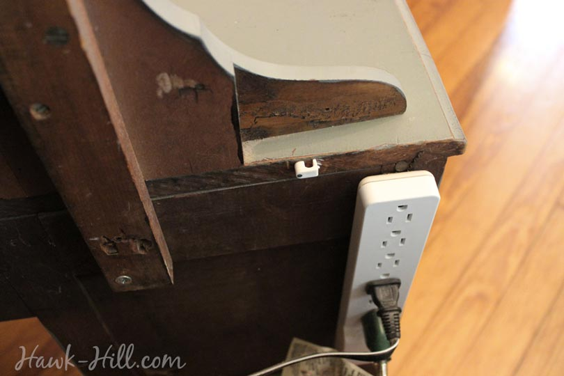 Place a power strip behind your nightstand