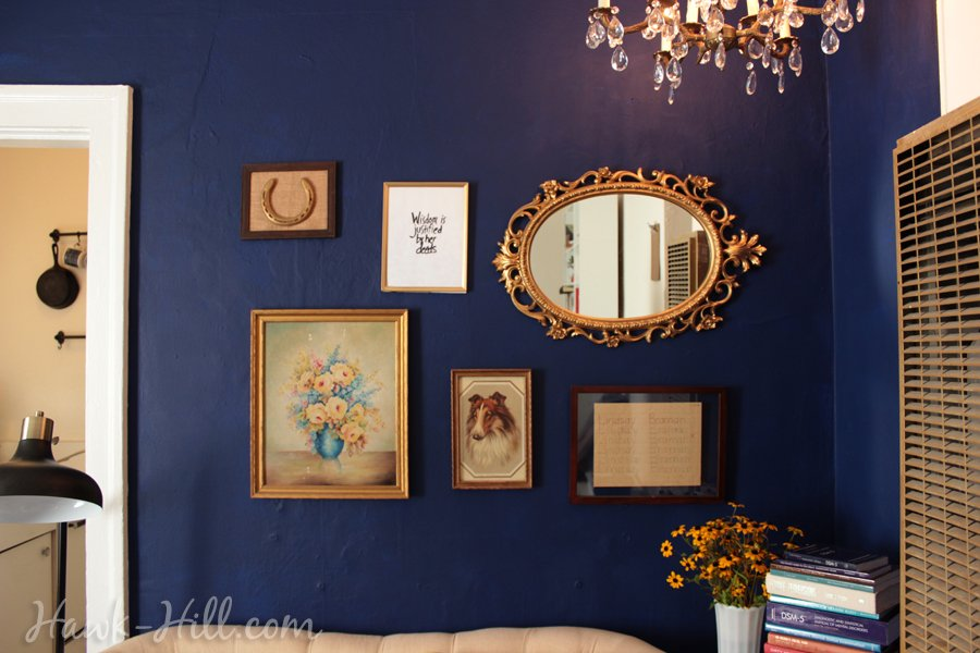 gallery wall with framed horse shoe