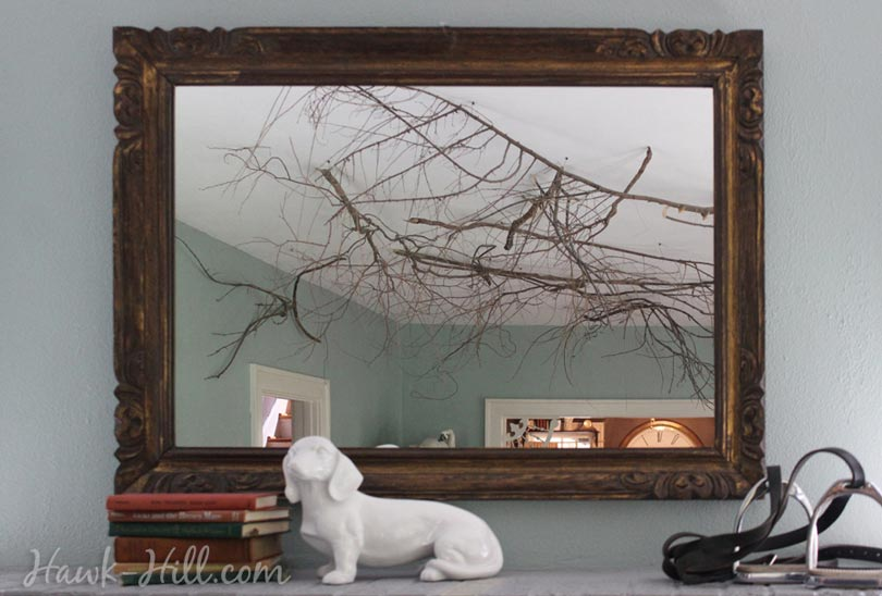 putting branches on the ceiling for whimsical decor