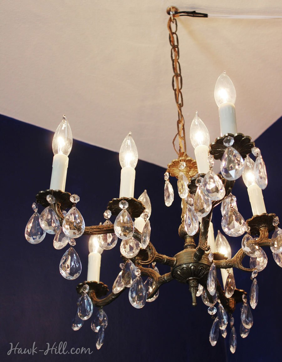 Hanging a chandelier in my studio apartment rental in seattle chandelier hung from a ceiling hook in an apartment with swagged cord arubaitofo Images