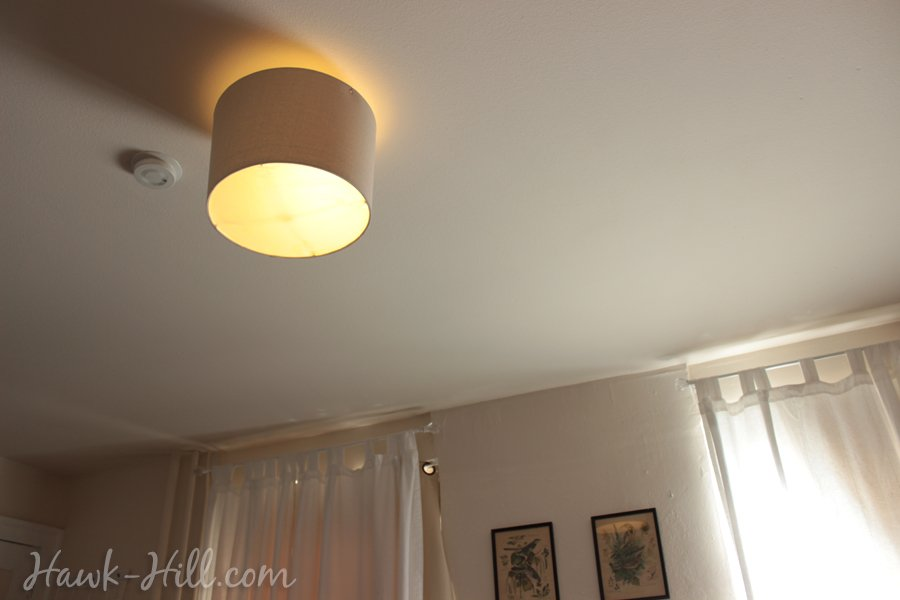 drum shade over an ugly rental light fixture