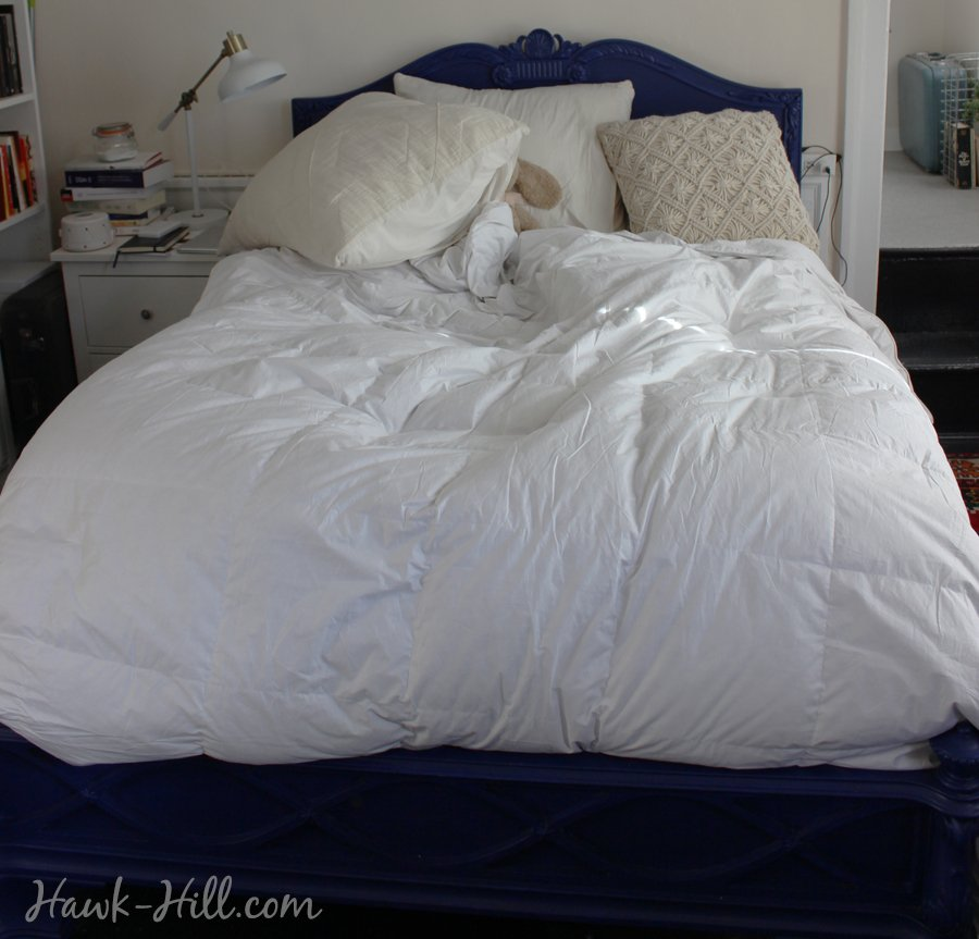 blue bed with down comforter