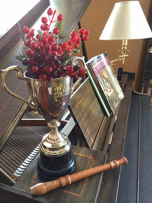 Trophy cup filled with red berries for christmas