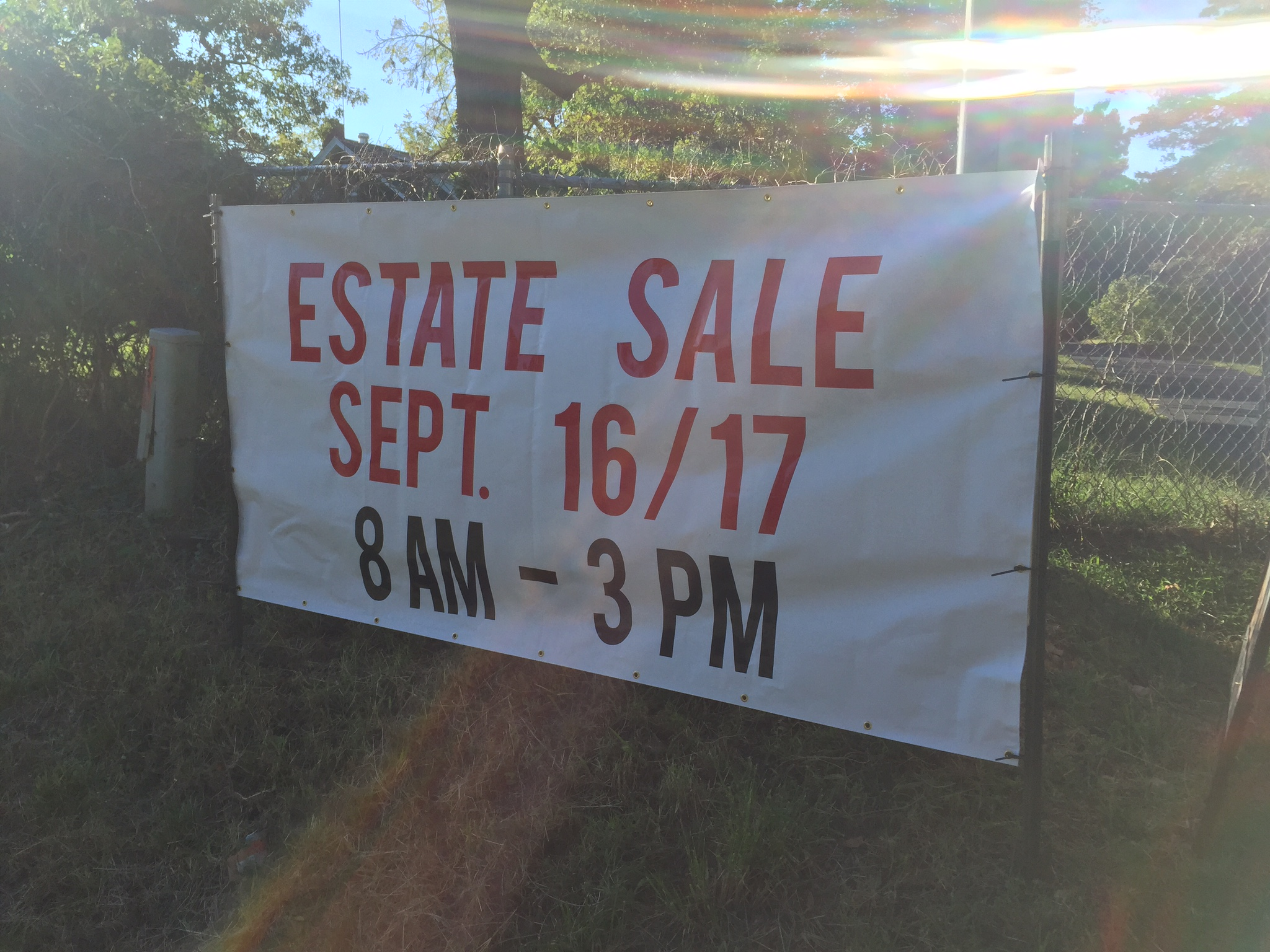 A sign advertising an estate sale