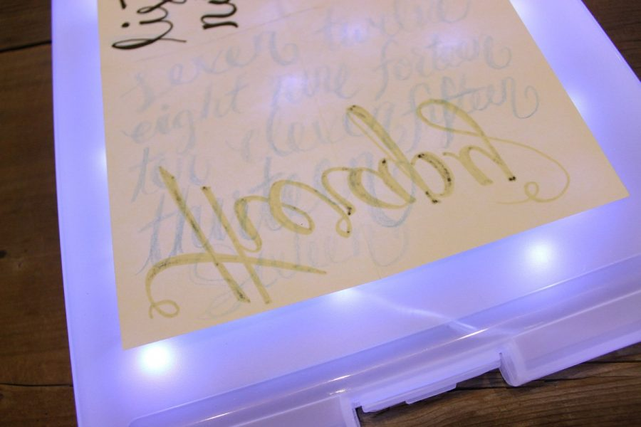 A portable light box for tracing makes practicing hand lettering much easier