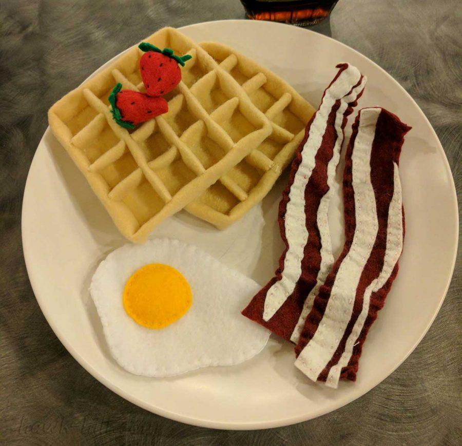 felt bacon eggs and waffleon a plate