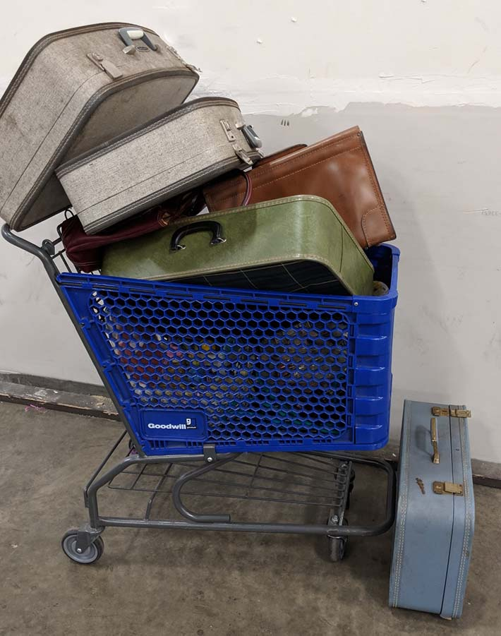Spoils of a morning at the Goodwill Outlet. I eventually put back all but the best and cleanest vintage suitcases.