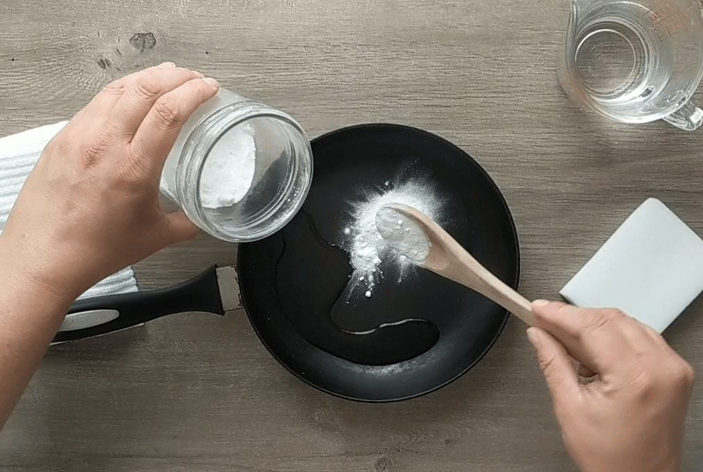 don't scrape! Use this mildly abrasive paste to restore a nonstick finish