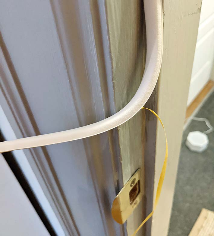 Stick the seal to the doorjamb so it's compressed when the door is shut