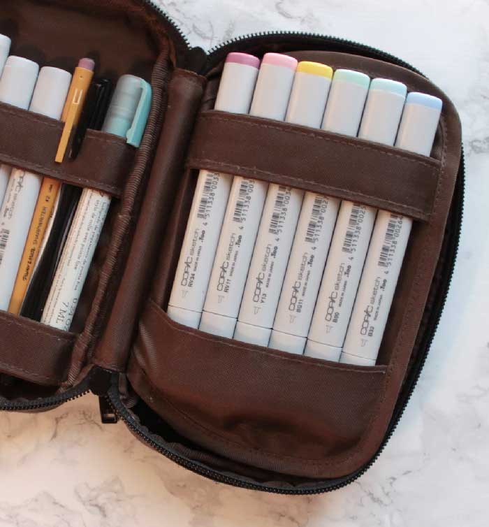 Pastel Copic art markers in a pen case sized perfectly for use in class