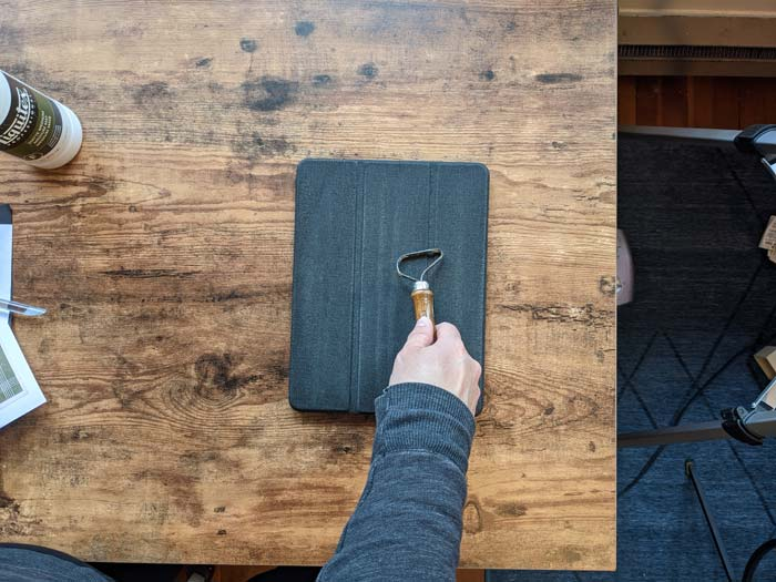 To start, rough up the surface of your iPad case so that your new pattern can adhere