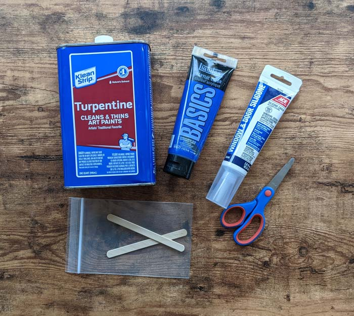 The supplies to make your own DIY silicone mold include turpentine acrylic paint silicone and a mixing bag