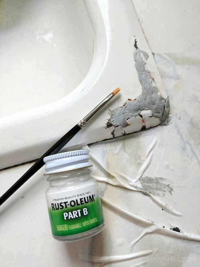 Use only special enamel paint for covering the patch- it's water resistant and has the sheen of a cast iron tub finish