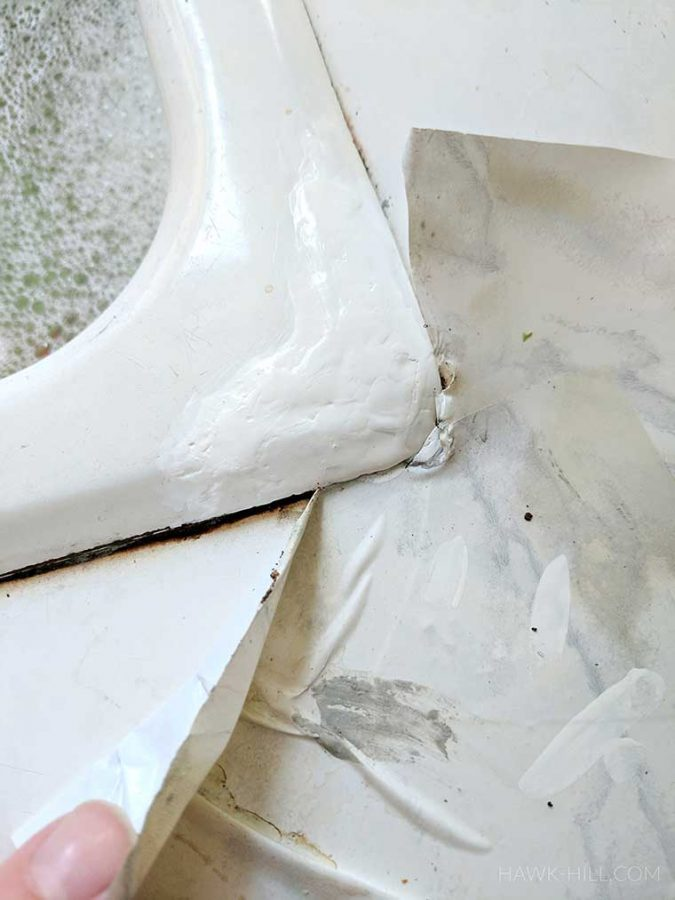 carefully apply paint to the tub or sink, over the patched portion