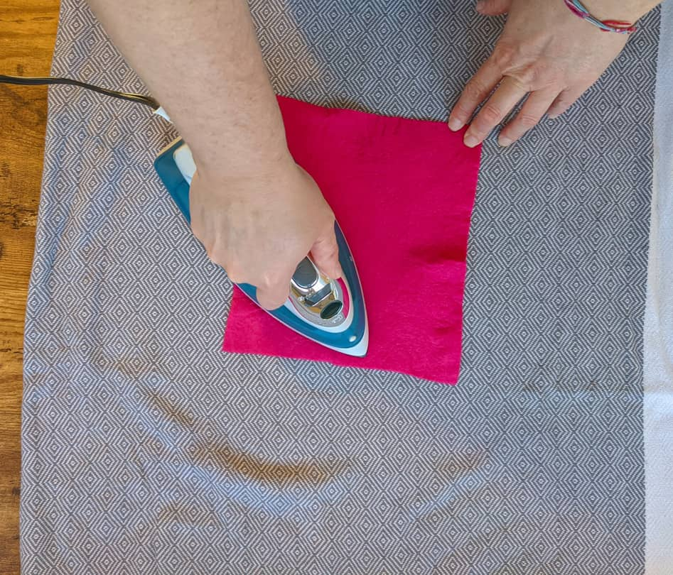 Ironing while still a bit damp can produce a completely flat stiff sheet of felt