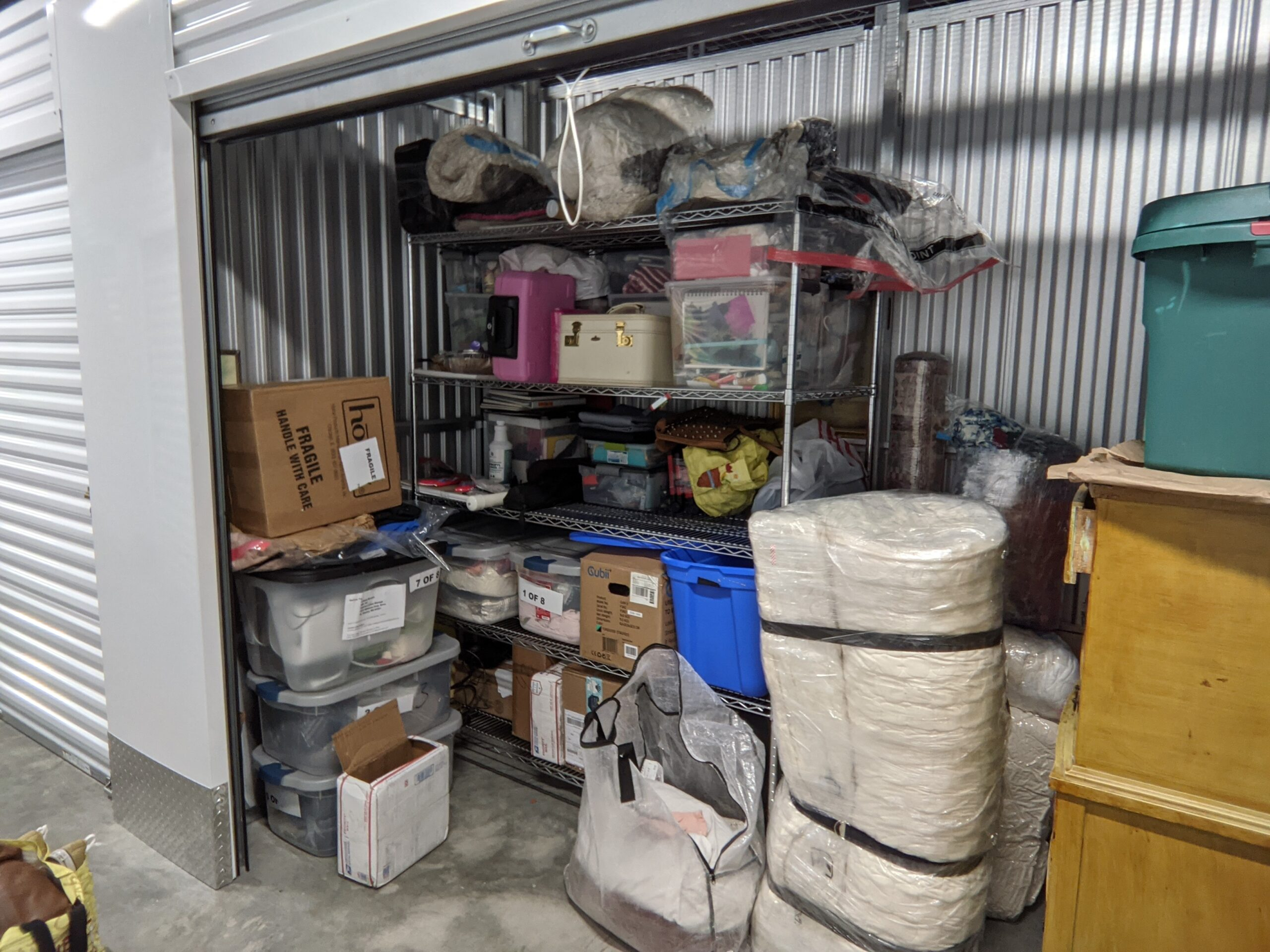 A rented storage unit filled with personal belongings.