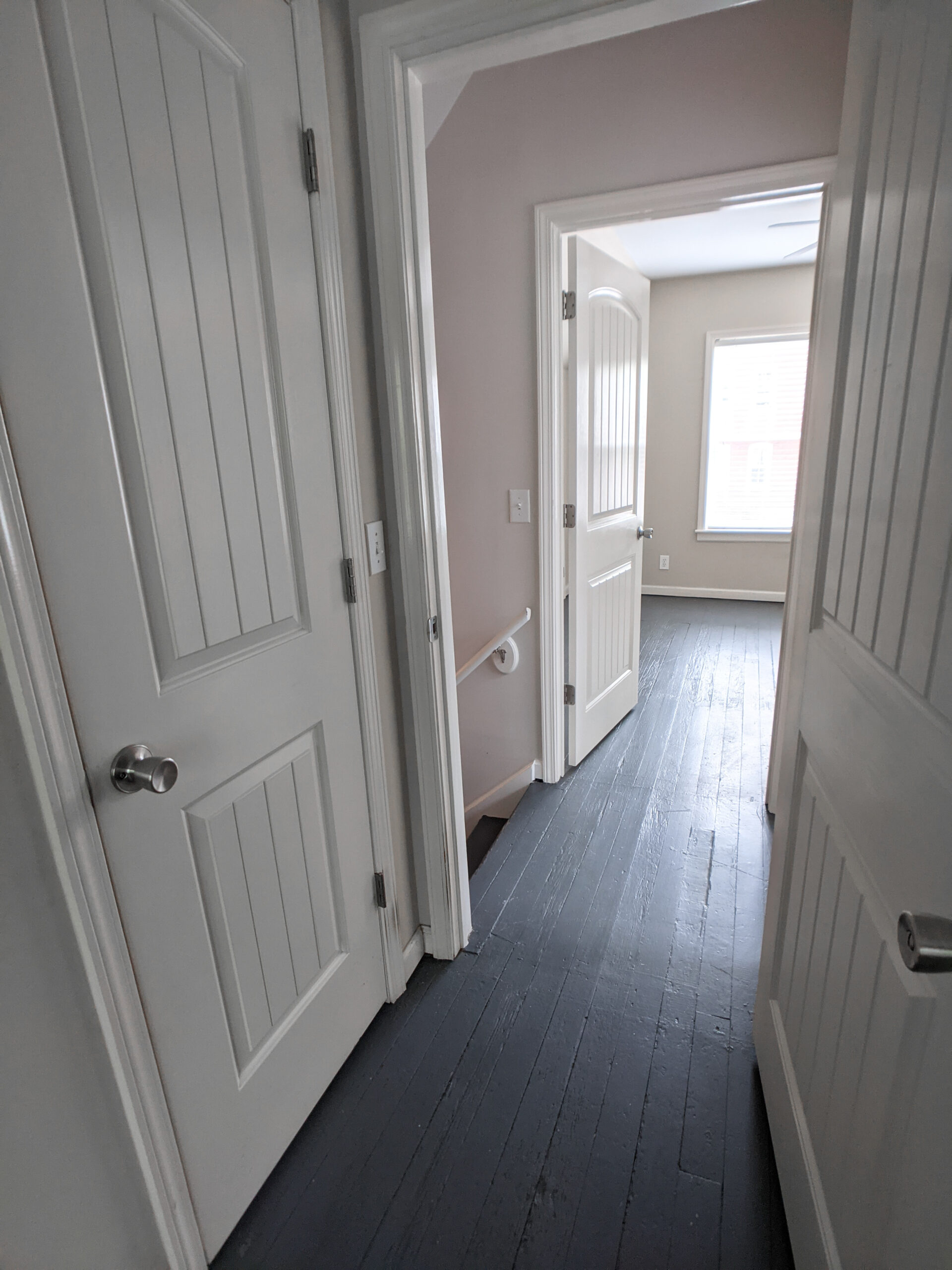 A landing looking into a second bedroom.