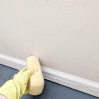 closeup of a beige wall being washed.