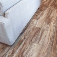 An image of Brentwood pine pergo laminate flooring in a home.