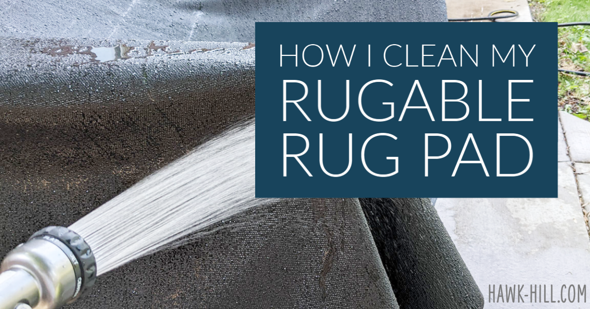 Cleaning a rugable rug pad with water.