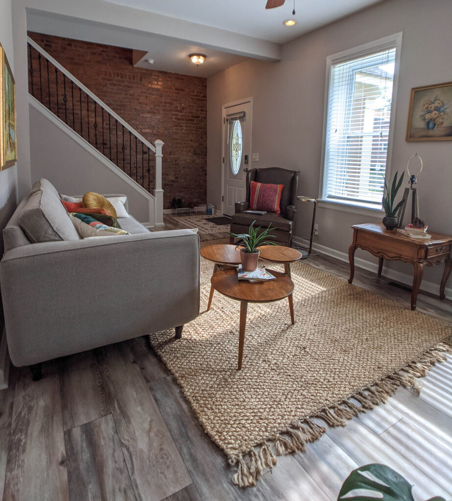 A cottage living room with eclectic furniture.