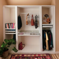 An IKEA wardrobe with bead board wallpaper attached.