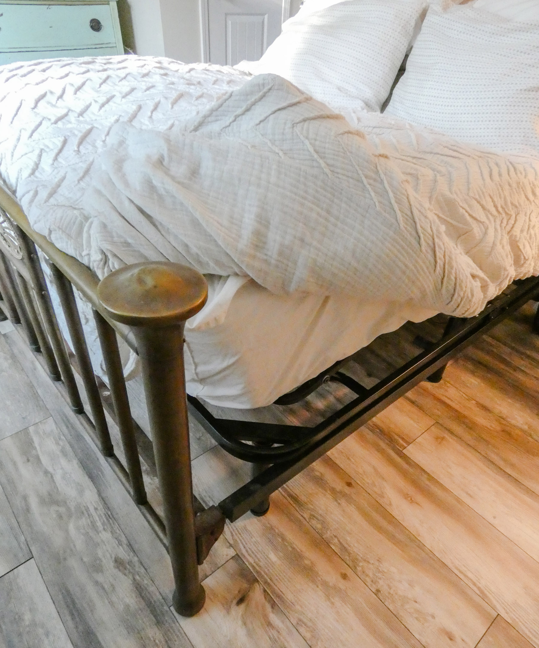 An adjustable base bed paired with an antique bedframe.