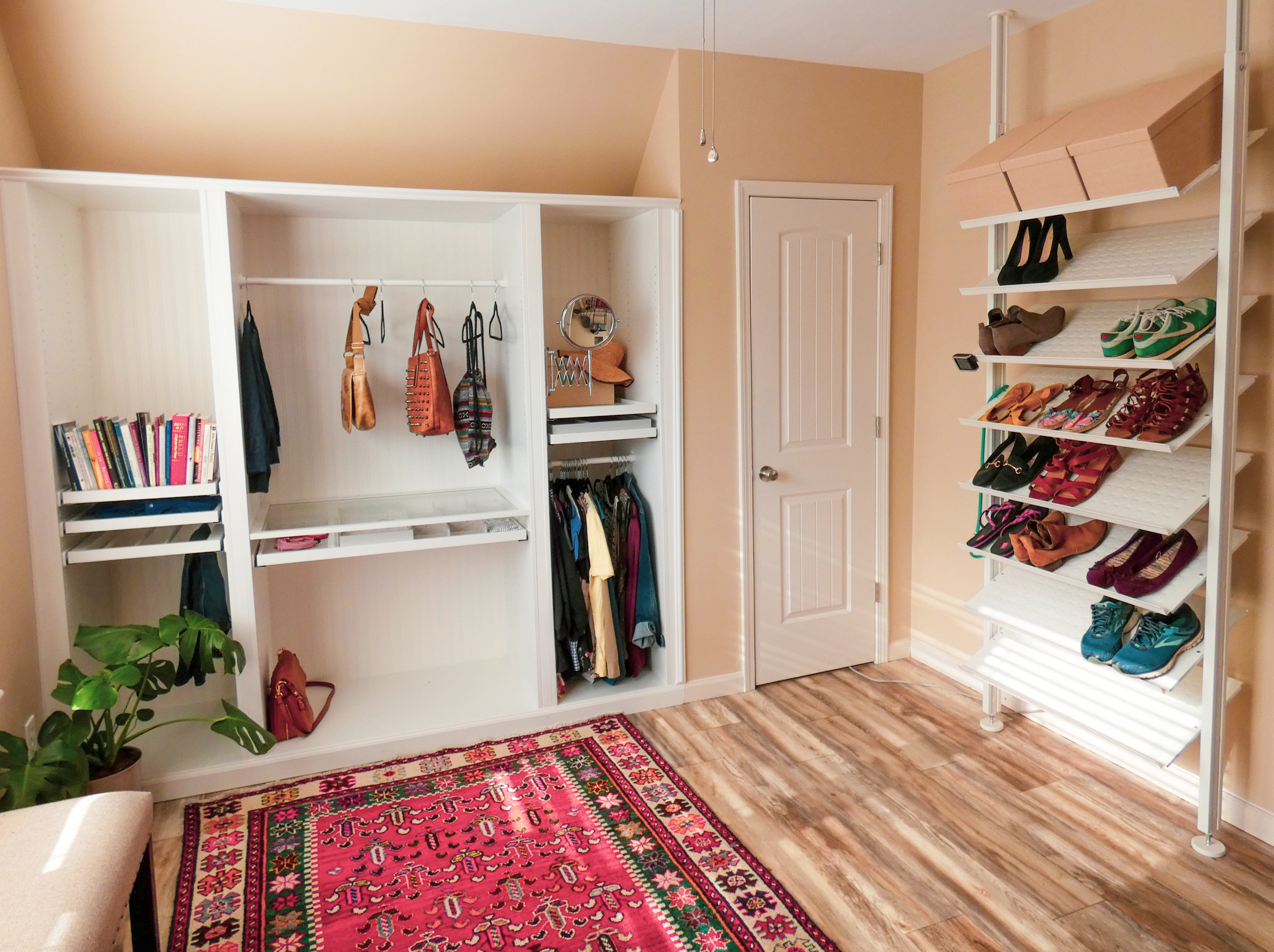 A built-in IKEA Pax wardrobe and floor to ceiling Elvarli shoe shelf in a dressing room converted from a bedroom.