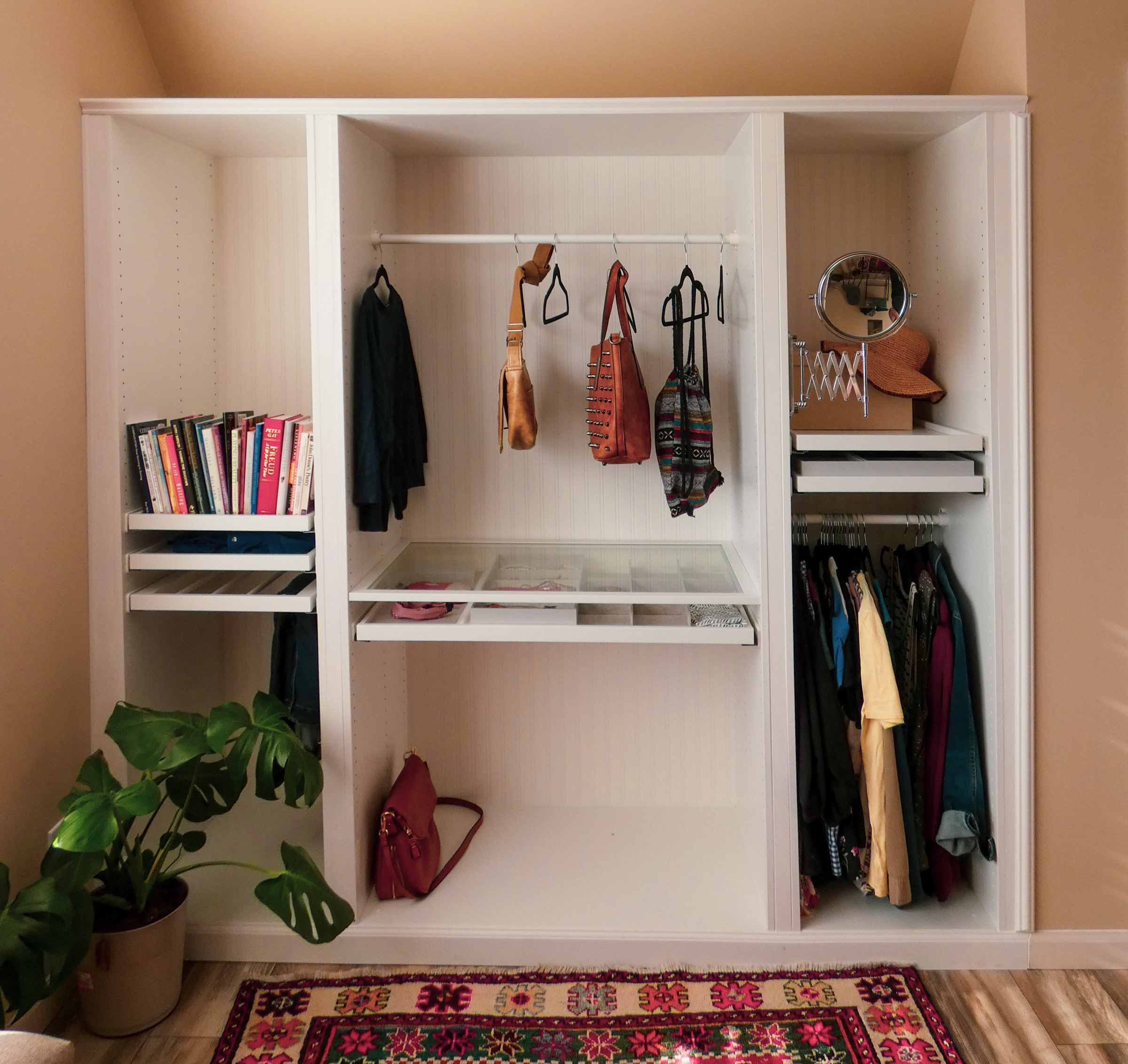 A wardrobe built into a wall of the bedroom.