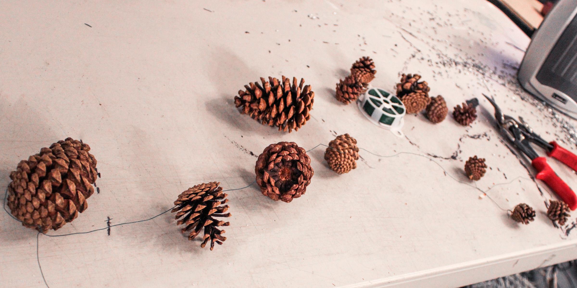 pinecones on a table, wired together.