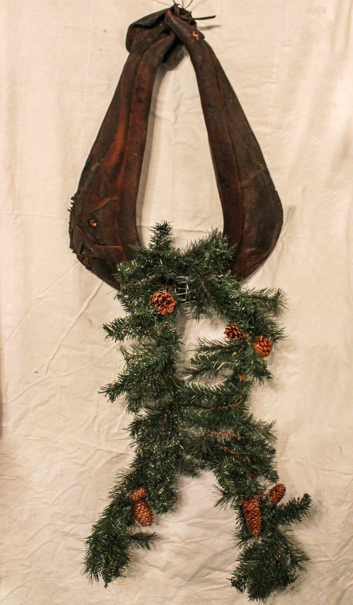 Horse harness with garland added and crossed.